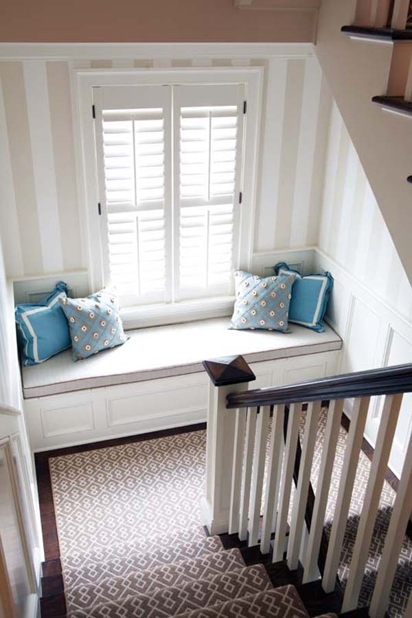 24.) Add a simple window seat to the landing of your staircase.