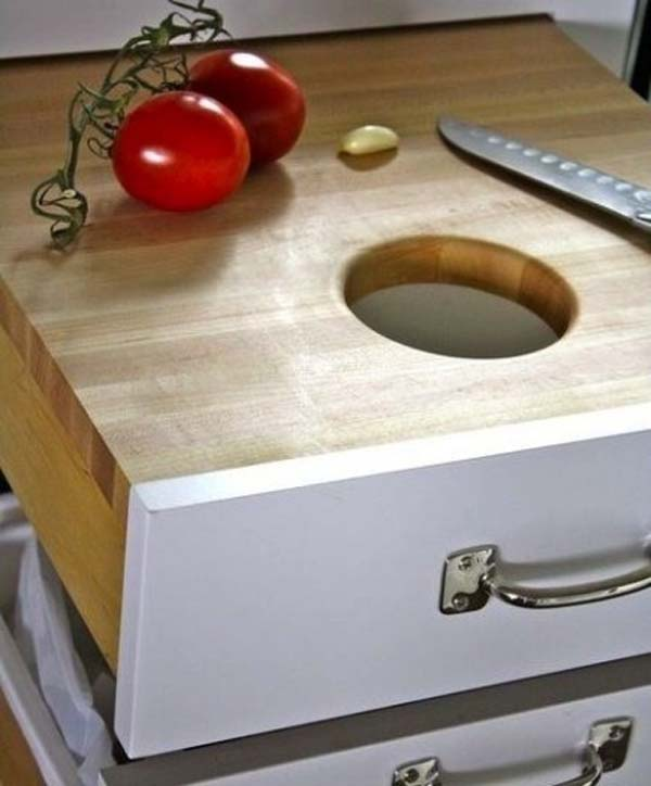 27.) Use kitchen drawers as cutting boards you can hide.