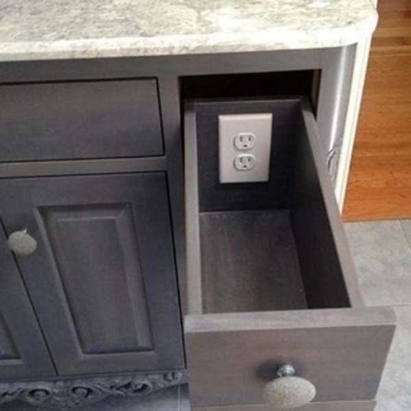 1.) Add outlets to drawers to keep clutter off of the table top.
