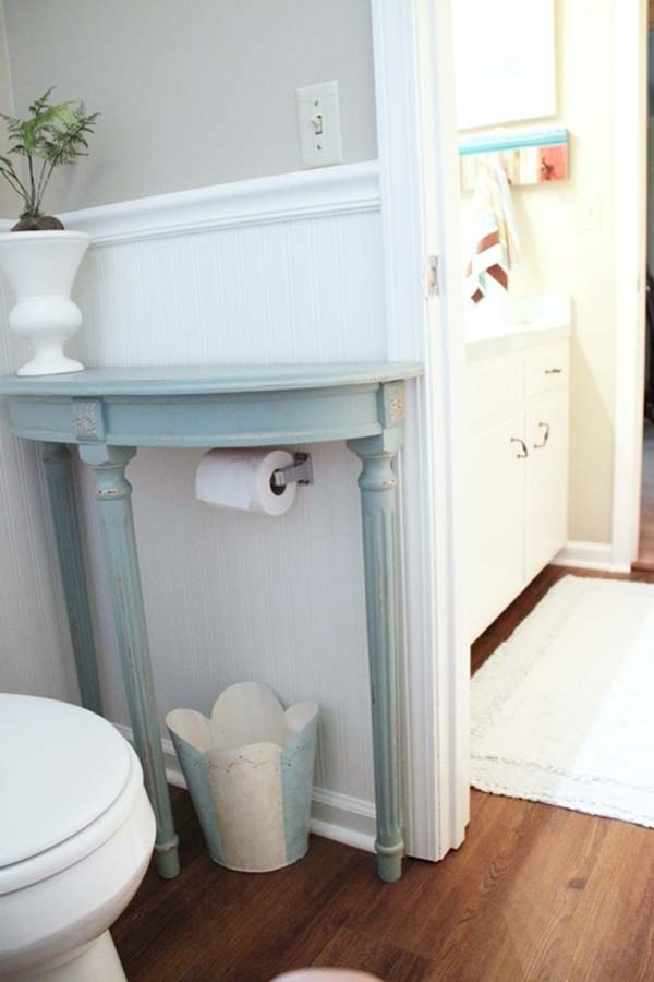 2.) Add a half-table to your bathroom for extra storage space.