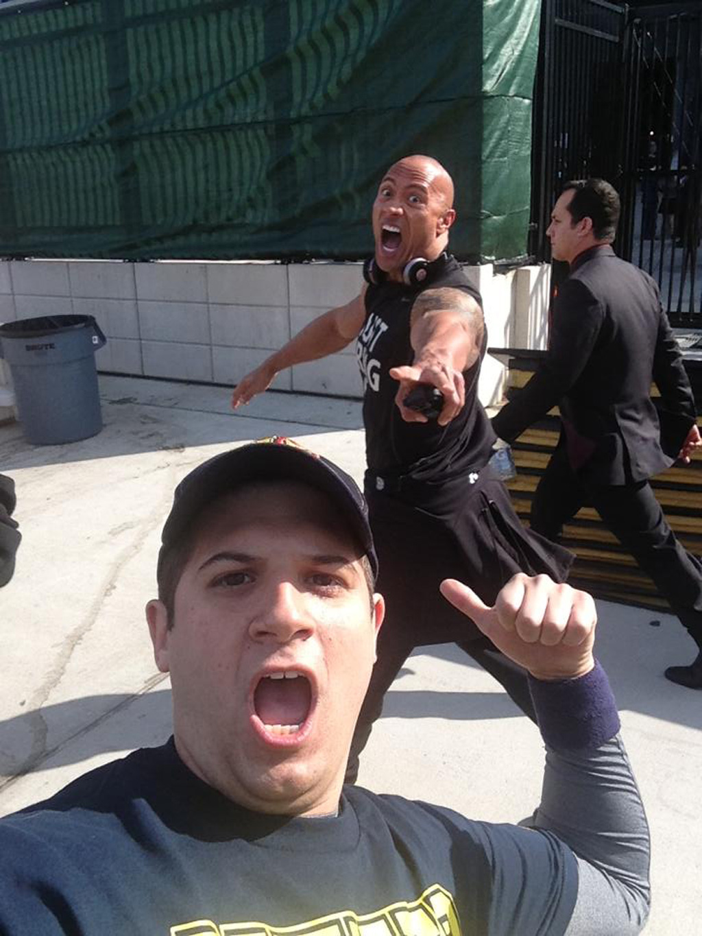 17) The Rock photobombs a fan.